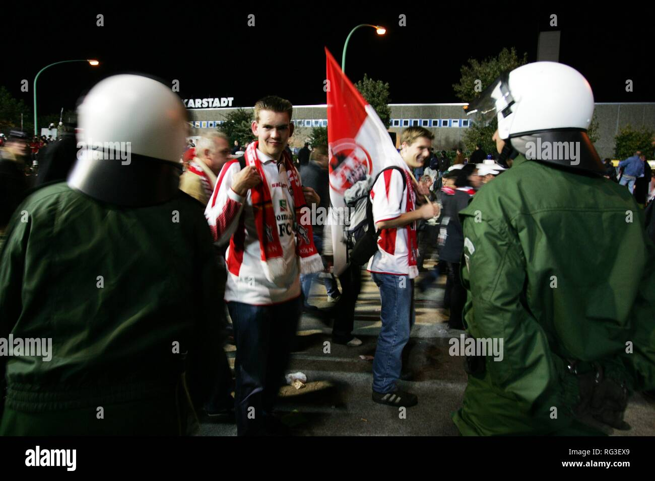DEU, Germany, Essen : Football fans form the 1.FC Koeln club at a game in Essen against Rot-Weiss Essen. Police is escorting the Stock Photo