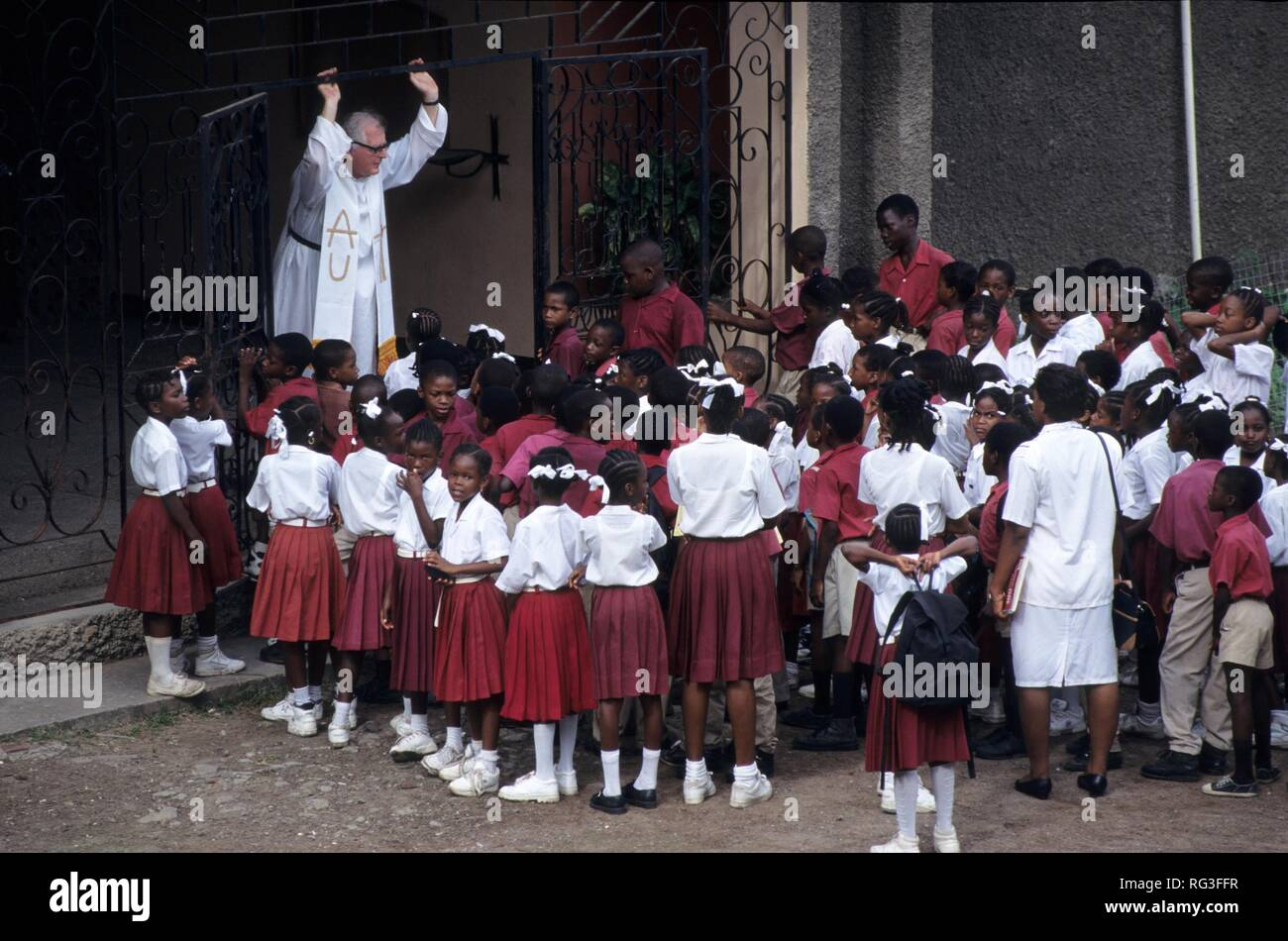 GRD, Grenada: pupils waiting in front of he school church, St. George's. - Stock Image