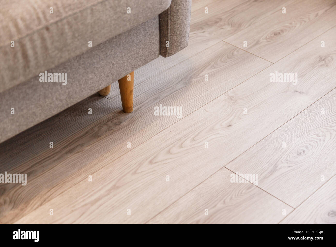 Surprising Grey Sofa With Wooden Legs On Lamonate Floor Stock Photo Theyellowbook Wood Chair Design Ideas Theyellowbookinfo