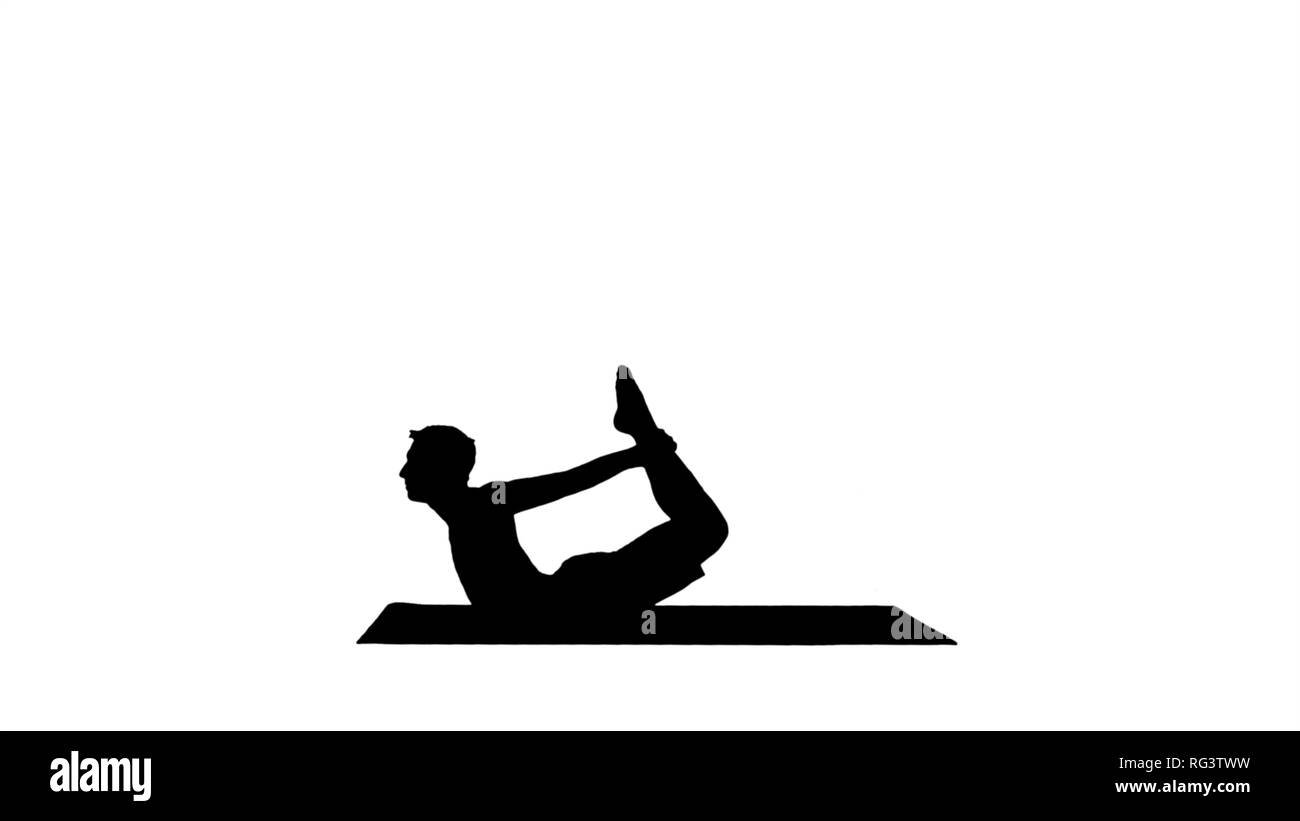 Silhouette Sporty muscular young yogi man doing backbend exercise, dhanurasana, Bow Posture. Professional shot in 4K resolution. 001. You can use it e - Stock Image