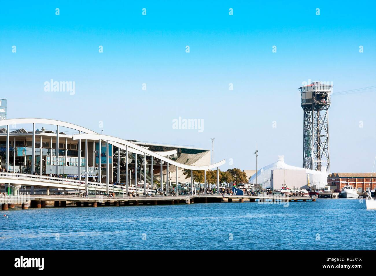 Barcelona, Spain - January 19, 2019: Port Vell in Barcelona with Maremagnum commercial center and cable car tower - Stock Image