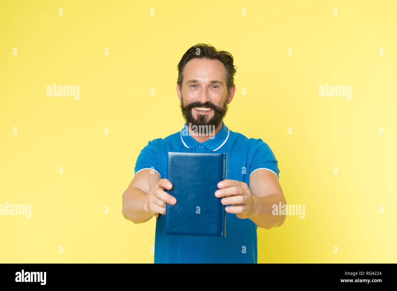 Literary critic. Man mature bearded guy hold book. Satisfied reader. Book presentation concept. Author presenting book copy space. Bestseller and book store. Literature taste and recommendations. - Stock Image