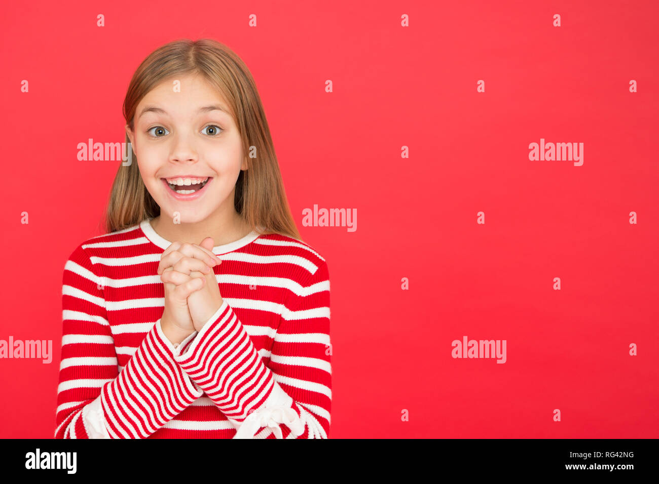 Believe in miracle. Child girl dreaming her wish come true. Miracle happens. Little girl smiling full of hope. My secret wish. Make a wish. Hope for the best. Girl hopeful excited face making wish. - Stock Image