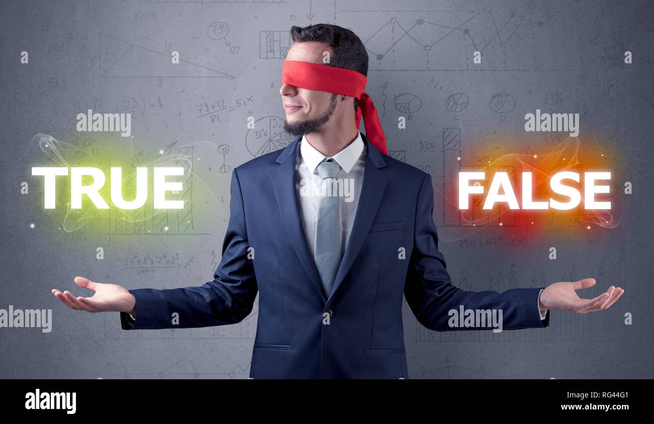 Businessman with red ribbon on his eye deciding true or false - Stock Image