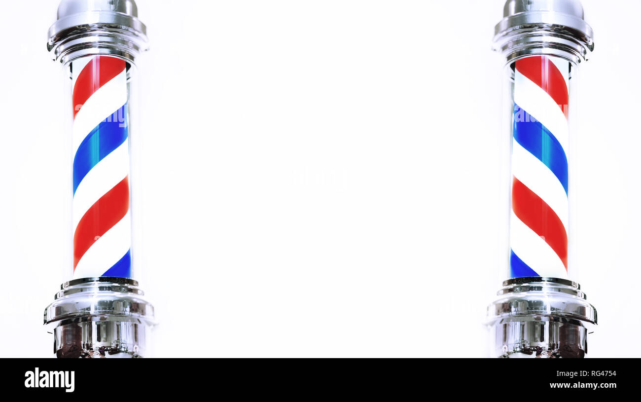 Barber's pole closeup on plain background. - Stock Image