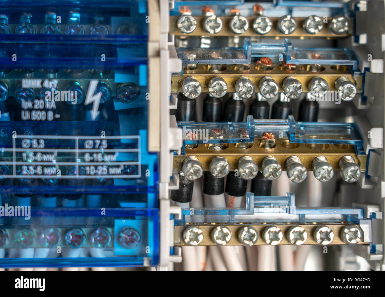 Terminals, contacts, circuit breakers wiring in electrical switchboard providing a safe supply of electricity - Stock Image