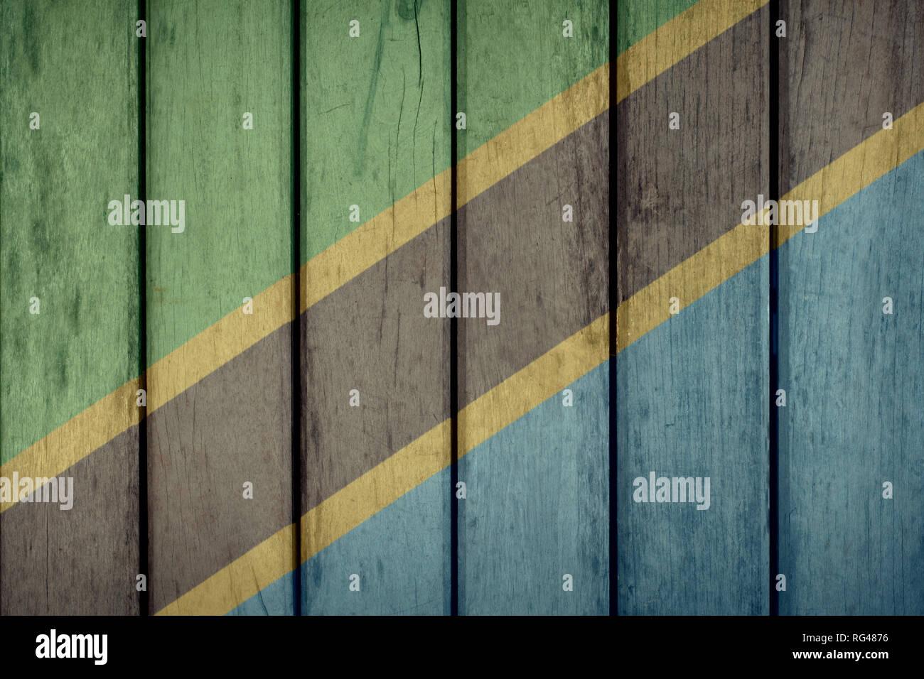 Tanzania Politics News Concept: Tanzanian Flag Wooden Fence - Stock Image