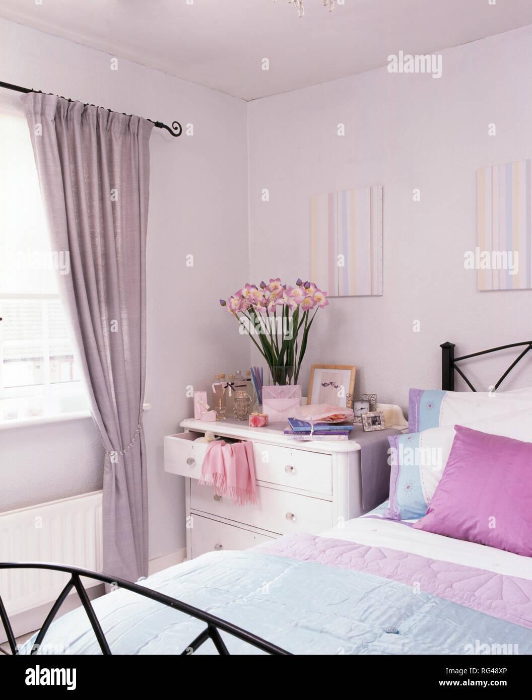 Mauve drapes on window in white bedroom Stock Photo ...