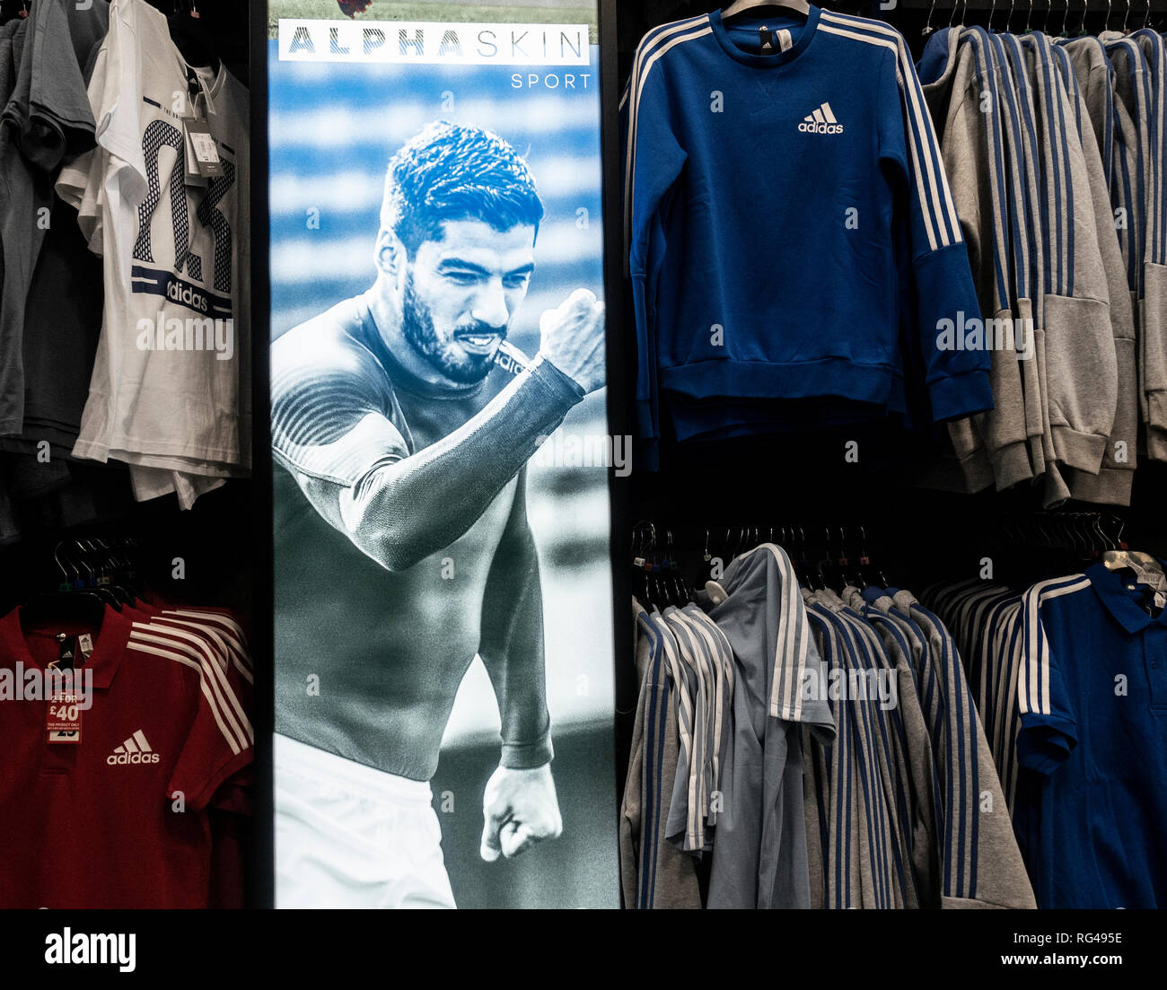 Instore Adidas display featuring footballer Luis Suarez in Sports Direct store. UK - Stock Image