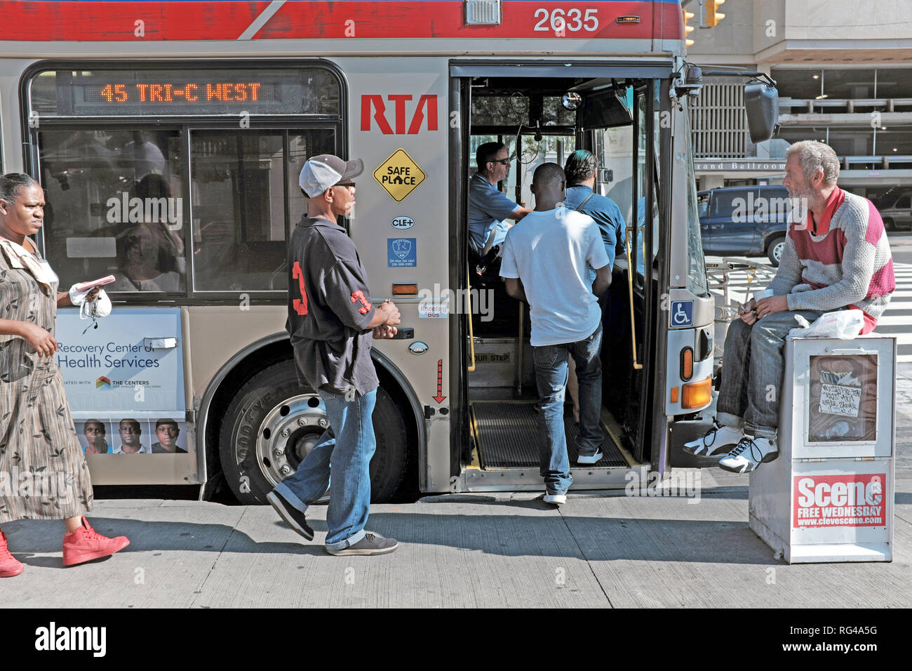 People board a public RTA bus in downtown Cleveland, Ohio, USA during the summer. Stock Photo