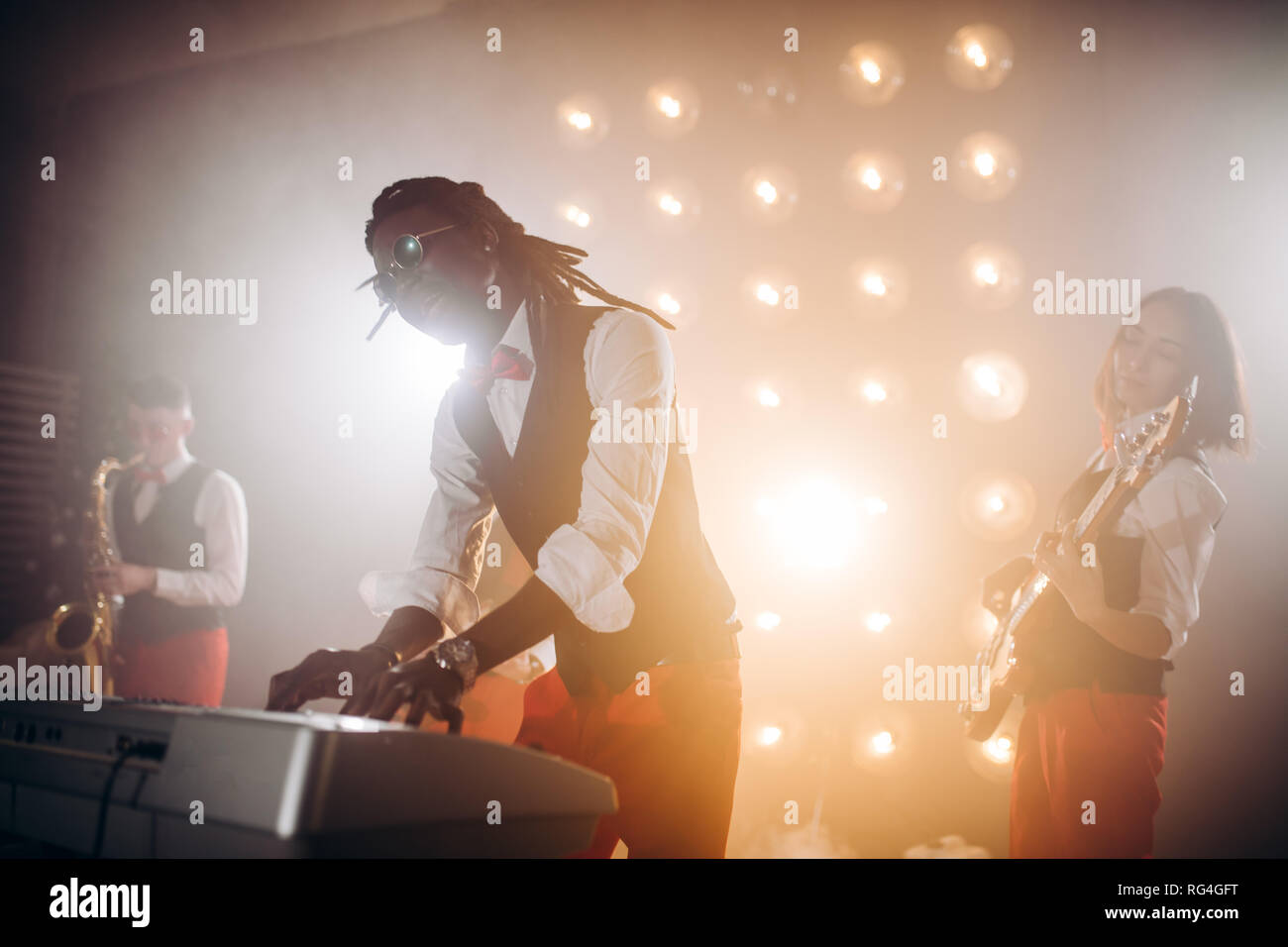 emotional playing on keyboard synthesizer piano and singing the song loudly - Stock Image