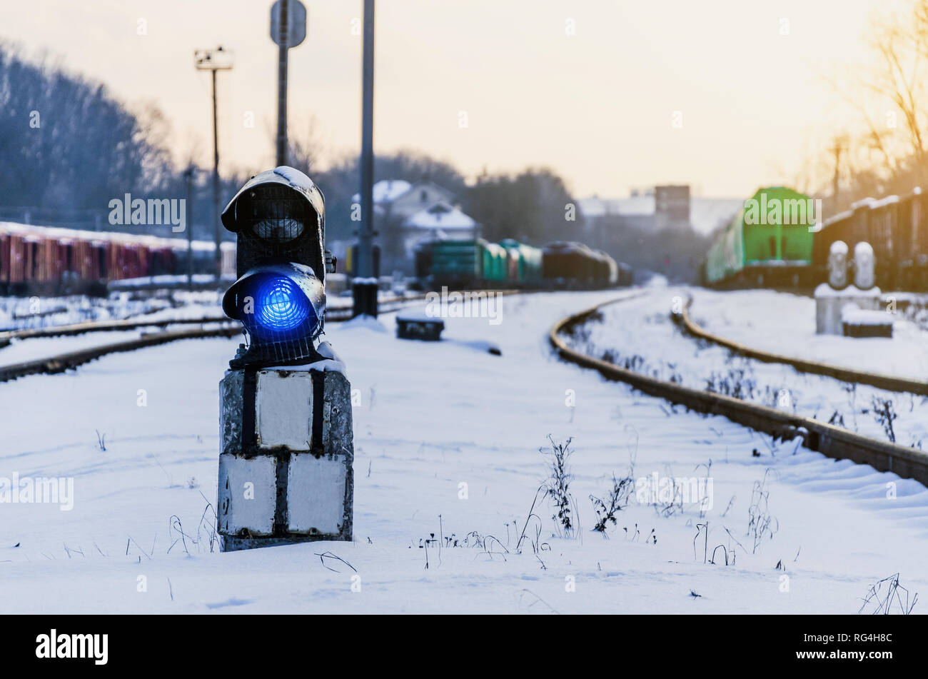 Vintage railway traffic light on old snow covered railway station. Trains, rails, travel, abandoned. Stock Photo