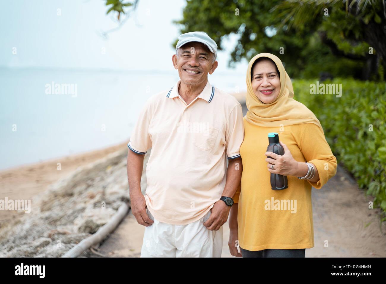 happy senior couple after exercising - Stock Image