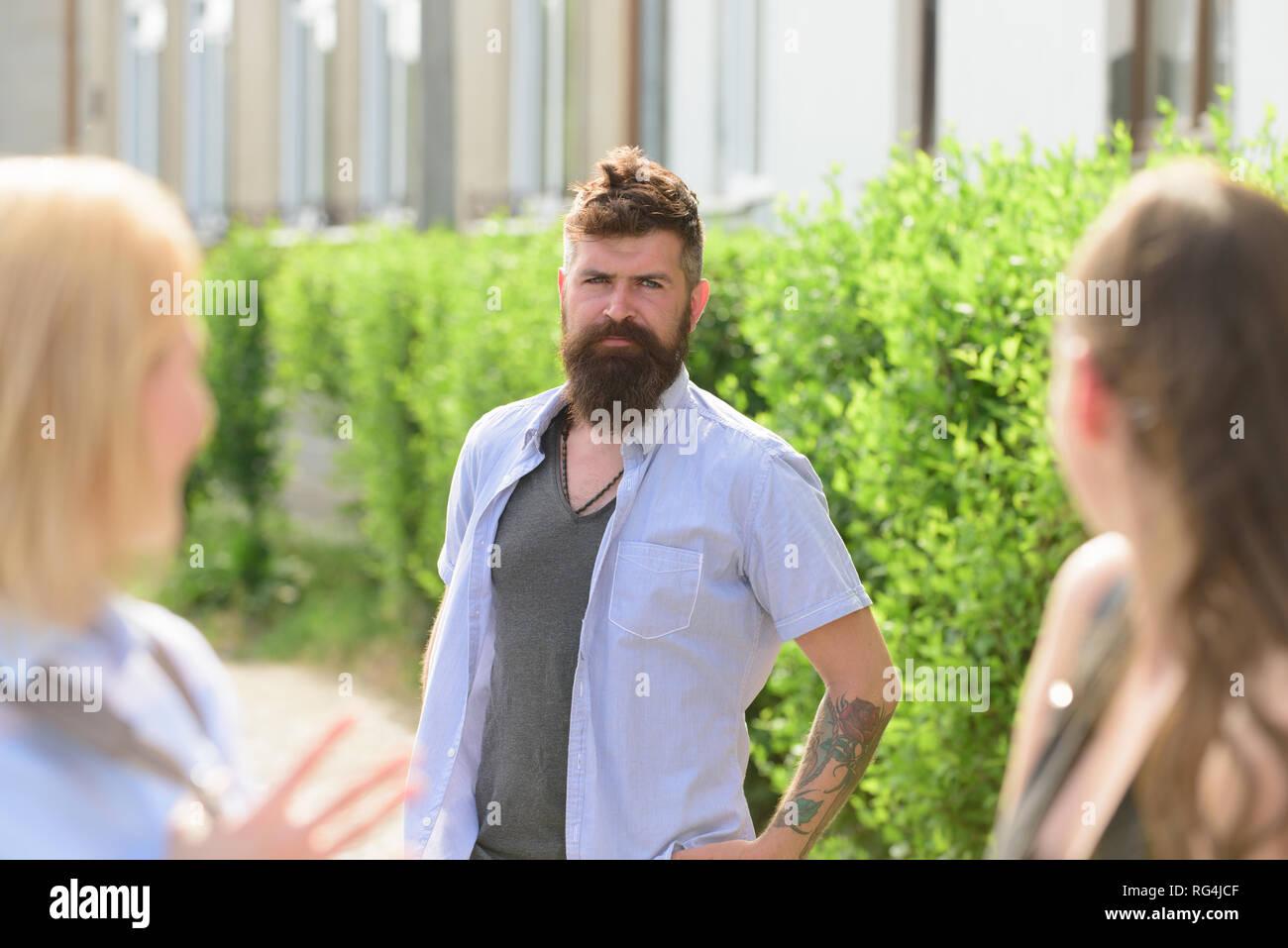 Lets be friends. Group of friends. Bearded man meeting women on street.  Boyfriend