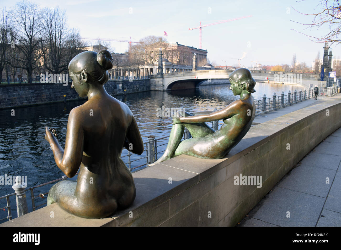 Three Girls and a Boy (Drei Madchen und ein Knabe) bronze statues on River Spree opposite Museum Island, Berlin, January 2019 Stock Photo
