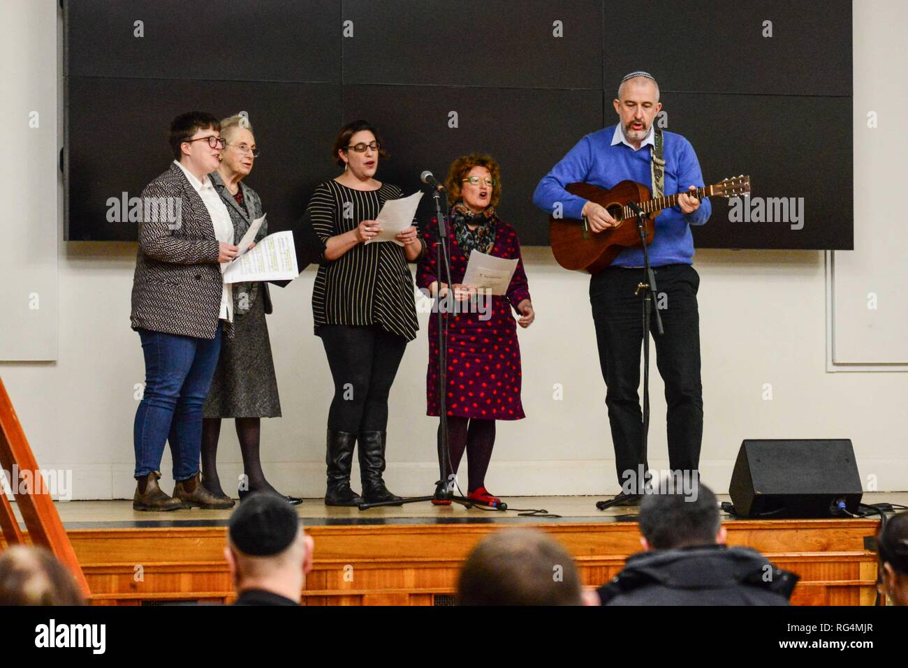 "London,UK. 27th Jan 2019.  Members of the choir of South London Liberal Synagogue perform at Holocaust Memorial Day ceremony in Lambeth Assembly Hall.. The theme for 2019 set by the Holocaust Memorial Day Trust is ""Torn from Home"".   Credit: Claire Doherty/Alamy Live News - Stock Image"