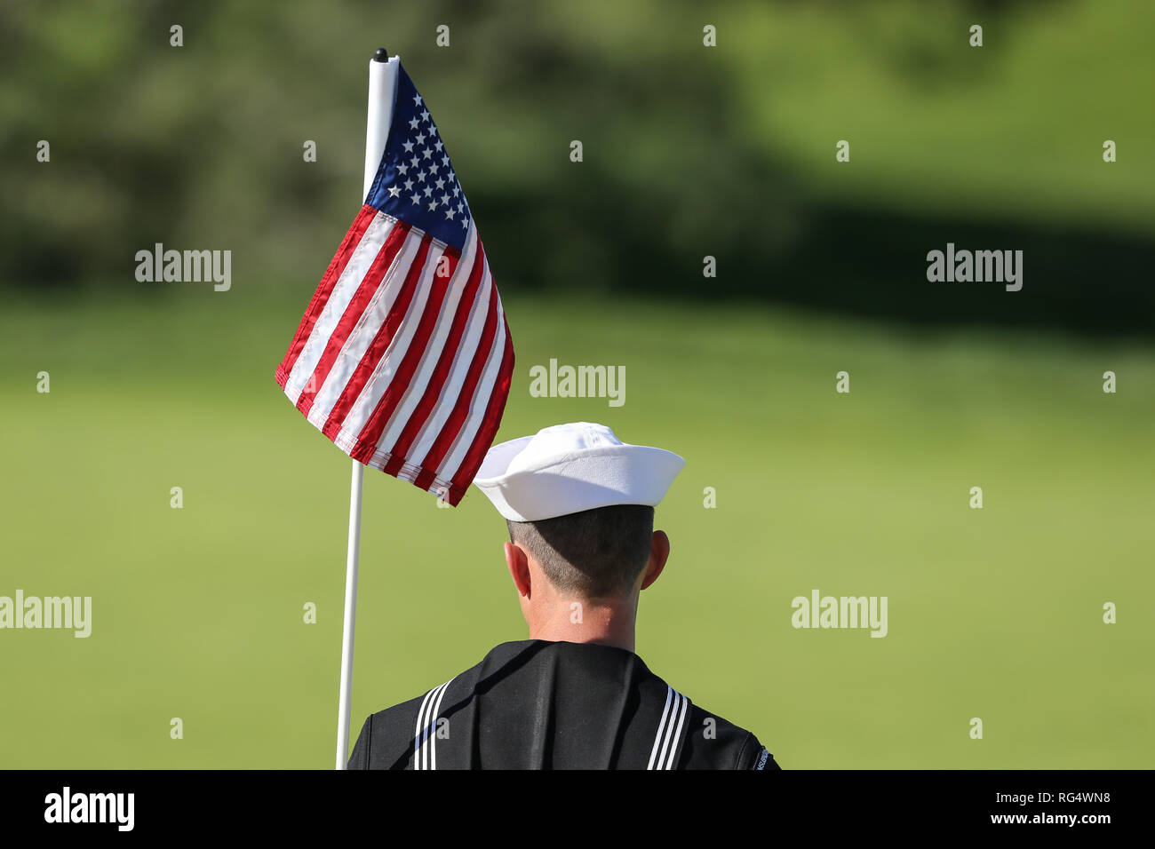 San Diego, California, USA. 27th Jan, 2019. Flag as US Flag held by service man during final round of the Farmers Open at Torrey Pines golf course in San Diego, Ca on January 27, 2019. Jevone Moore Credit: csm/Alamy Live News - Stock Image