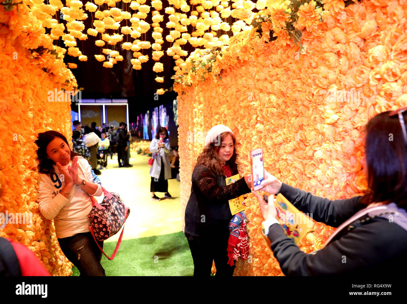 Hong Kong, China. 27th Jan, 2019. Visitors take selfies at a fair with the theme of auspicious animals from Chinese mythology in Times Square in Hong Kong, south China, Jan. 27, 2019. With appealing design and connotation of luck and fortune, the fair attracted many visitors. Credit: Wu Xiaochu/Xinhua/Alamy Live News Stock Photo