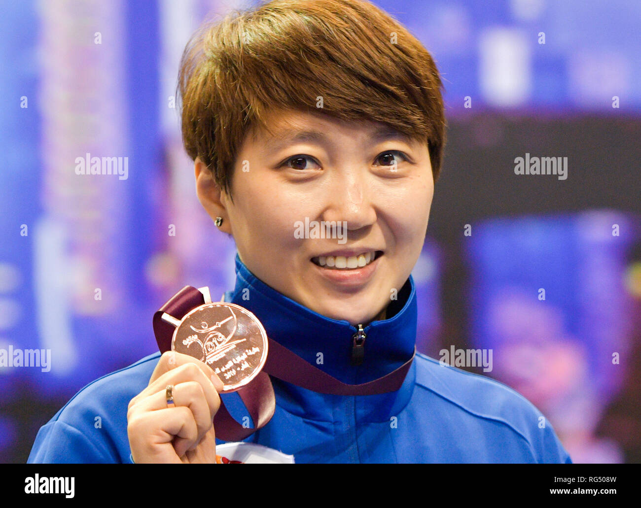 Doha. 27th Jan, 2019. Bronze medallists Hyojung Jung of South Korea celebrates on the podium during the awarding ceremony of the women?s Epee Grand Prix at the aspire academy in the Qatari capital Doha on Jan. 27, 2019. Credit: Nikku/Xinhua/Alamy Live News - Stock Image
