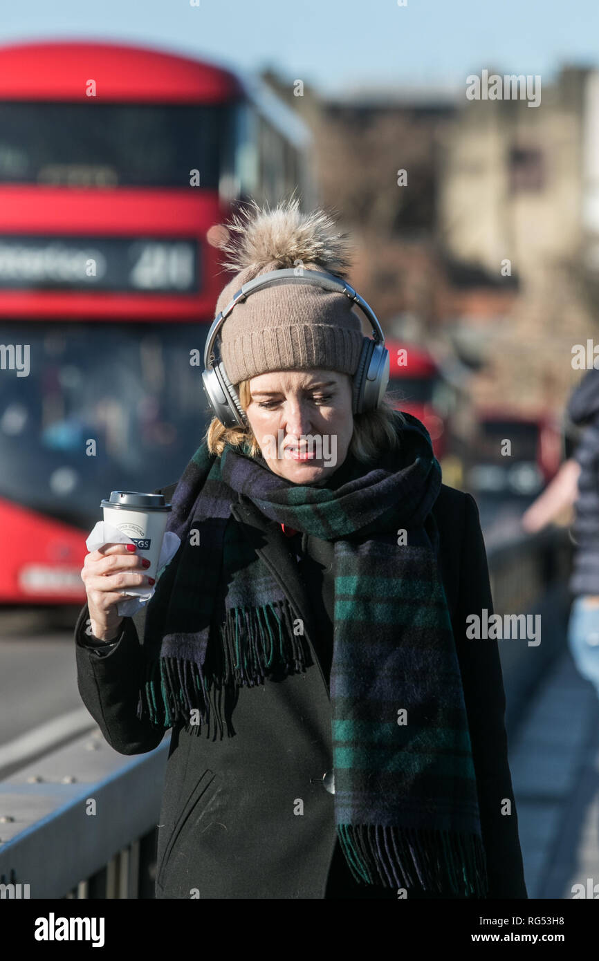 London, UK. 28th Jan, 2019. UK Weather: Pedestrians wrap up warm on Westminster Bridge on a cold and bright Winter morning in London Credit: amer ghazzal/Alamy Live News Stock Photo