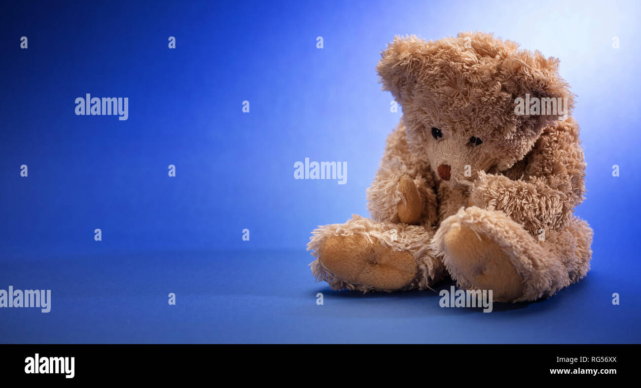 Blue Monday, depression concept  Teddy bear sad, sitting in