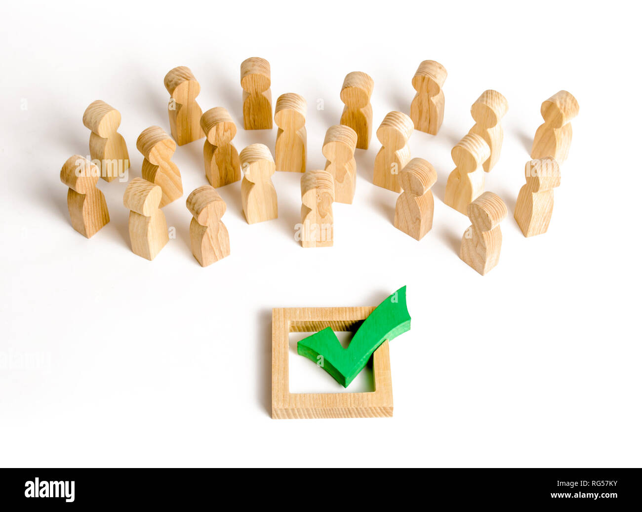 A crowd of people looks at a green check mark. Voting and election concept. Referendum, revolution. Forcible overthrow. Making the right decision, maj - Stock Image