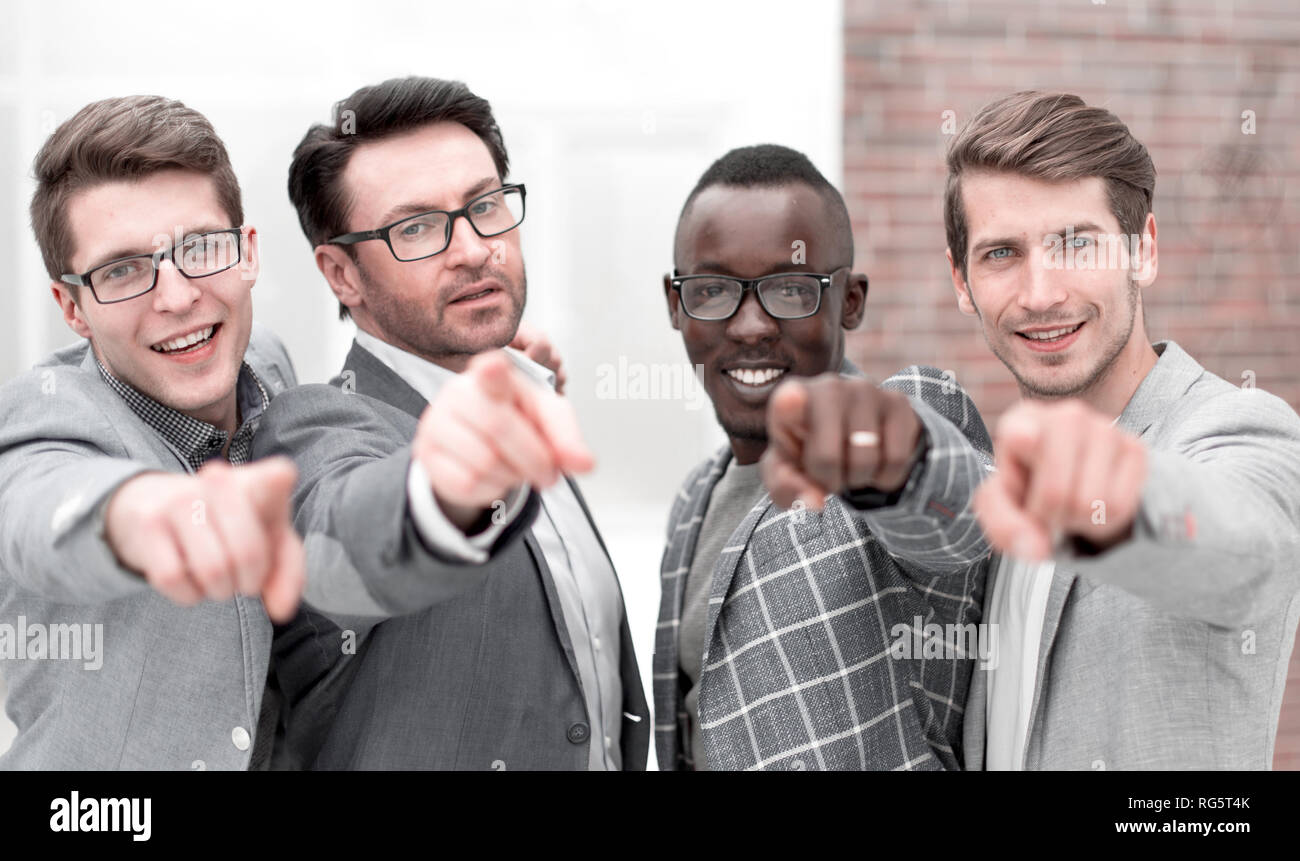 multinational business team pointing at you. - Stock Image