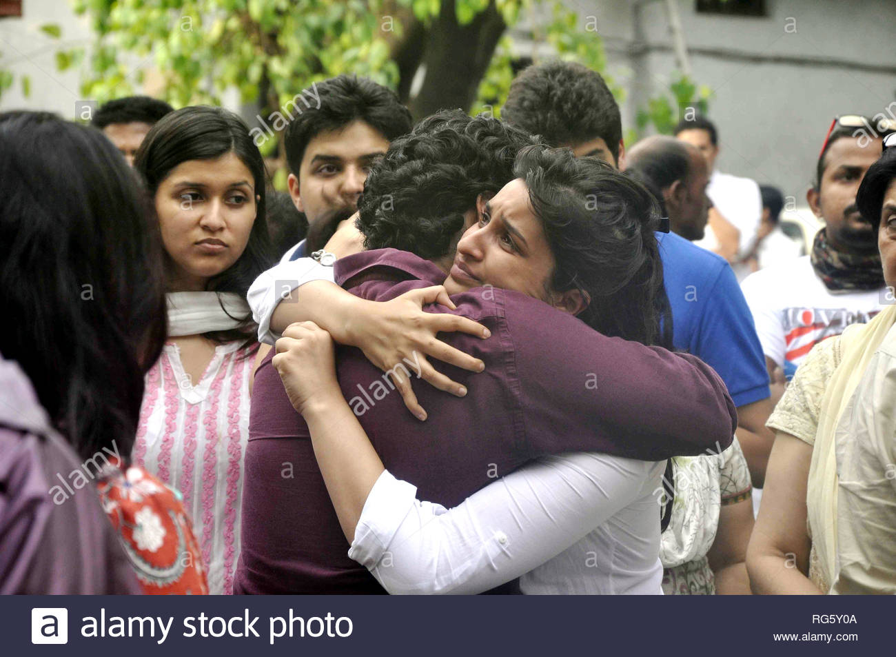 Bollywood  actress Parineeti Chopra being consoled on the death of her uncle (Priyanka Chopra's father) Ashok Chopra who was cremated in Mumbai, India on June 10, 2013. Lt Col Ashok Chopra, a retired Army doctor, was undergoing cancer treatment for the past few years. (Deven Lad) - Stock Image