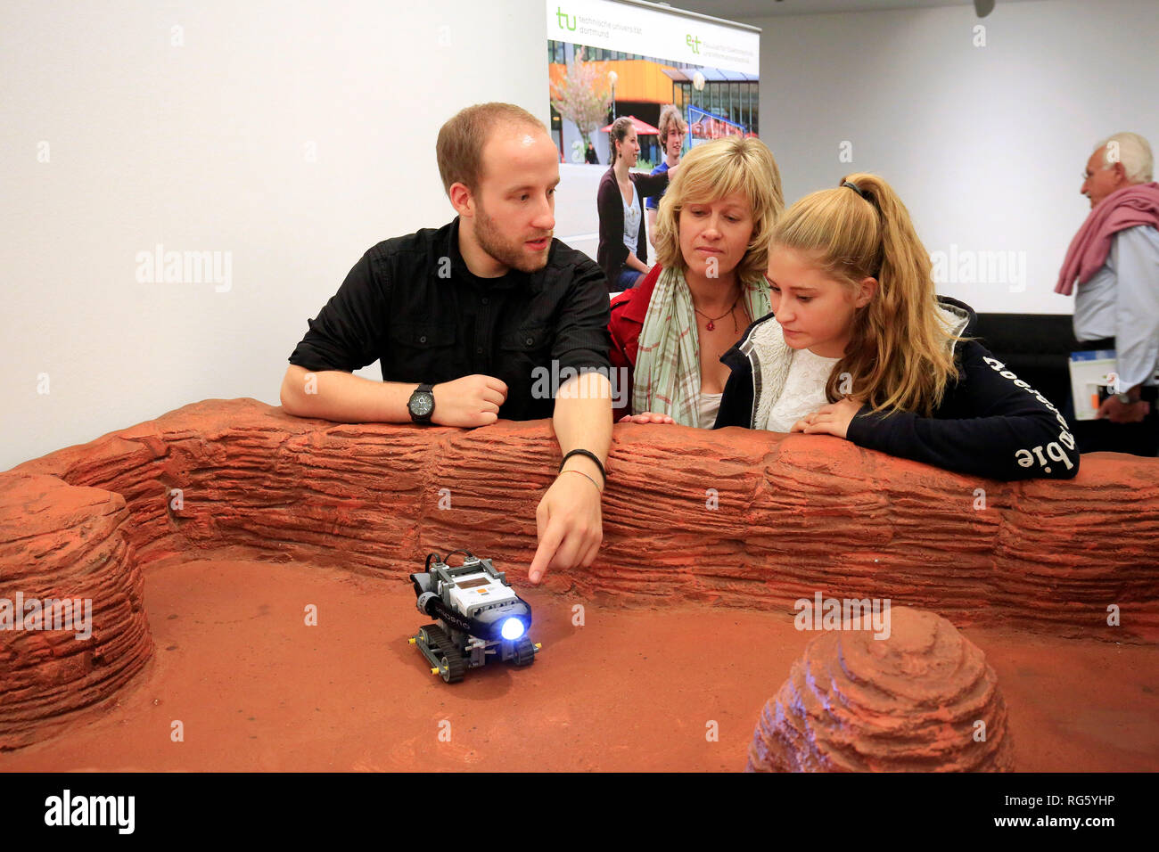 Family visits the exhibition, marvels at a Mars robot at the booth MISSION TO MARS, Wissensnacht Ruhr, a project for the climate metropolis Ruhr 2022, Stock Photo