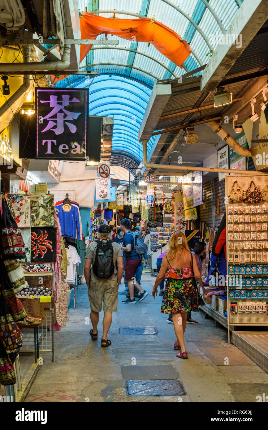 People walking through the undercover Stanley Market, Stanley, Hong Kong - Stock Image