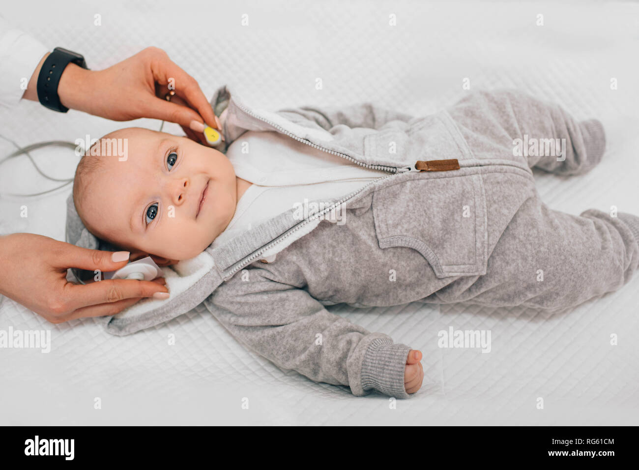 Hearing Test baby , Cortical auditory evoked potential analyzer. hearing screening - Stock Image