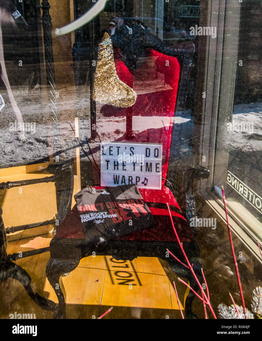 A closer look thru the window of Stratford Theatre Store. You see some items related to 'Lets Do Time Warp' musical horror play. - Stock Image