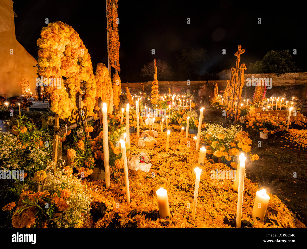 The candelit cemetery of Arocutin, Michoacan, Mexico during Day of the Dead. - Stock Image