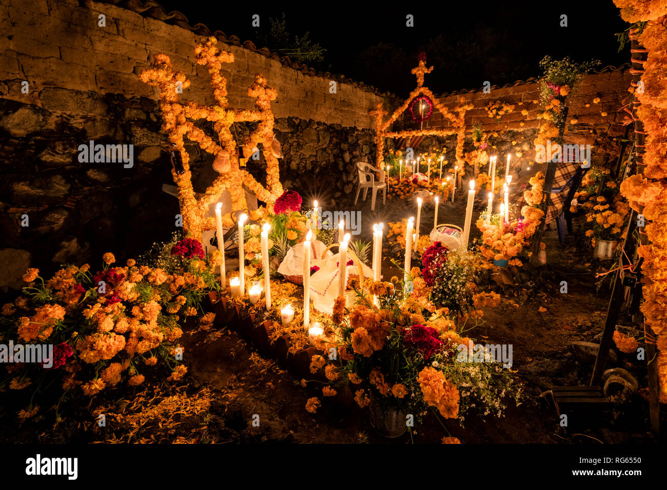 A corner of the cemetery in Arocutin, Michoacan, Mexico during Day of the Dead. - Stock Image