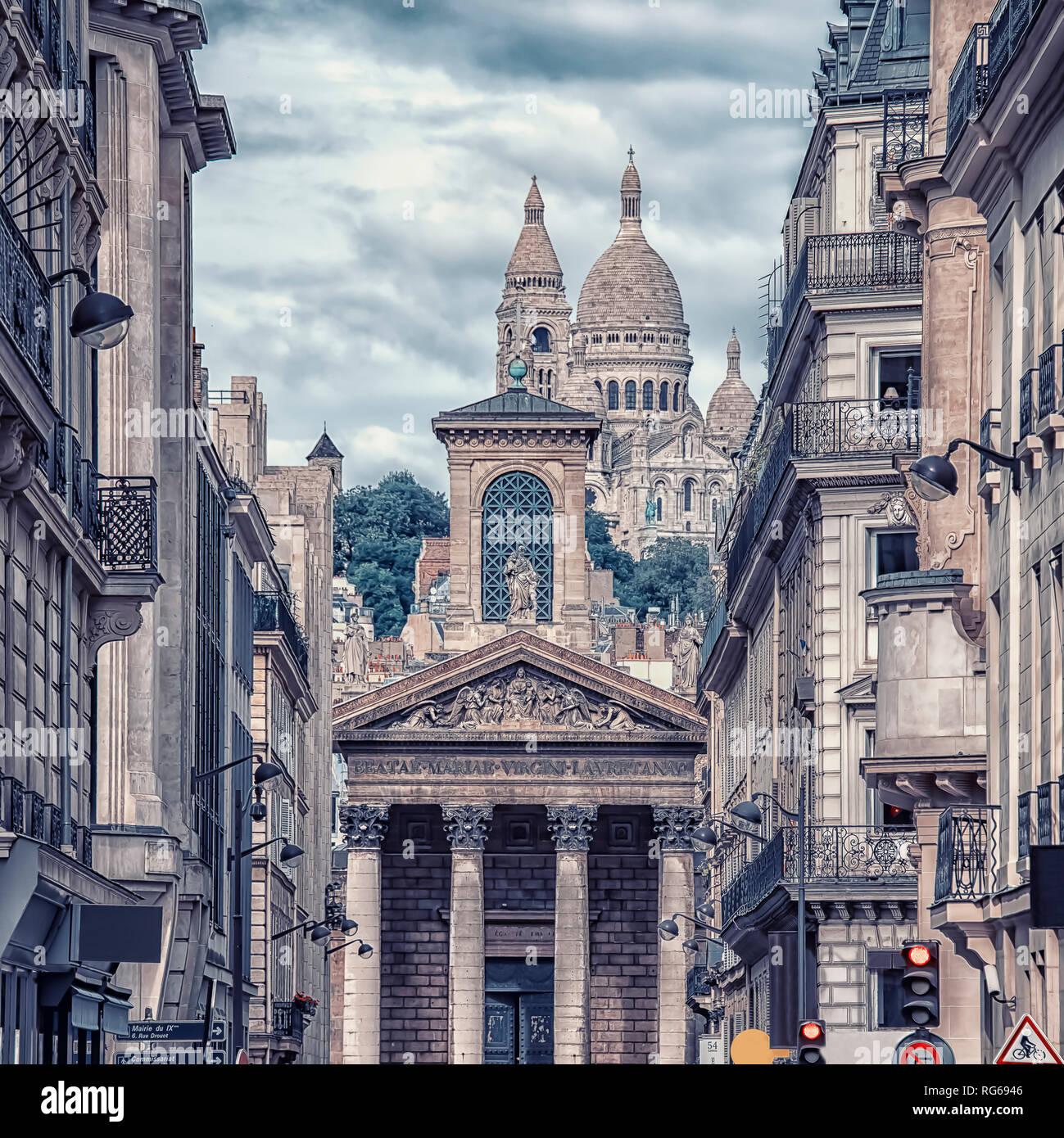 Sacre coeur viewed from Rue Laffitte street in Paris Stock Photo