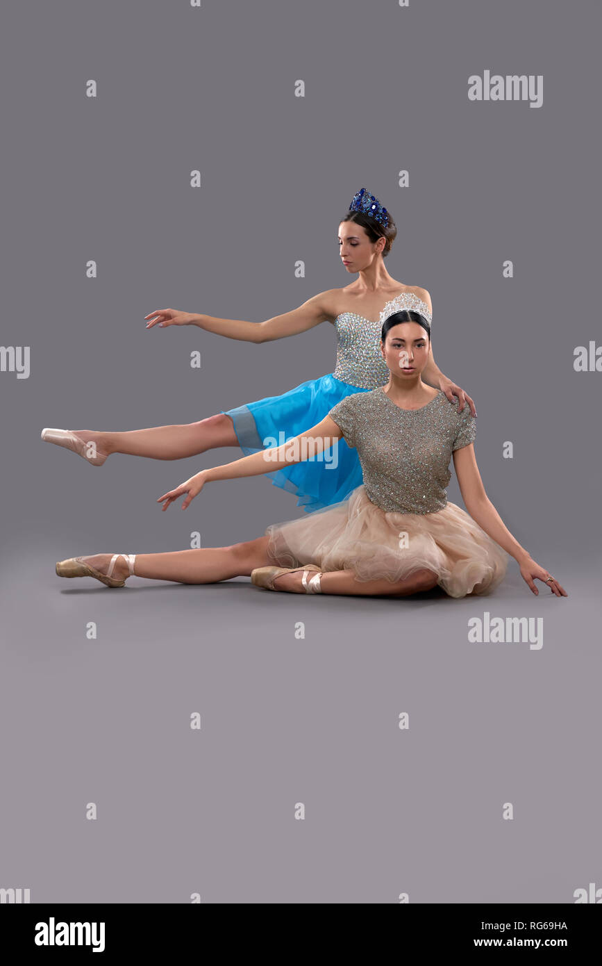 new product be566 01213 Front view of serious ballerina in beige dress sitting on ...