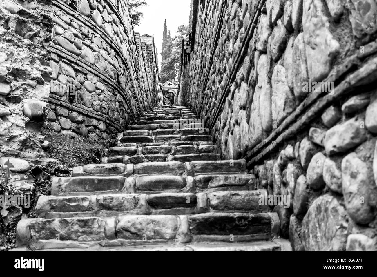 Stone stairs and stone arch after rain. The Monastery of St. Nino at Bodbe, Georgia - Stock Image