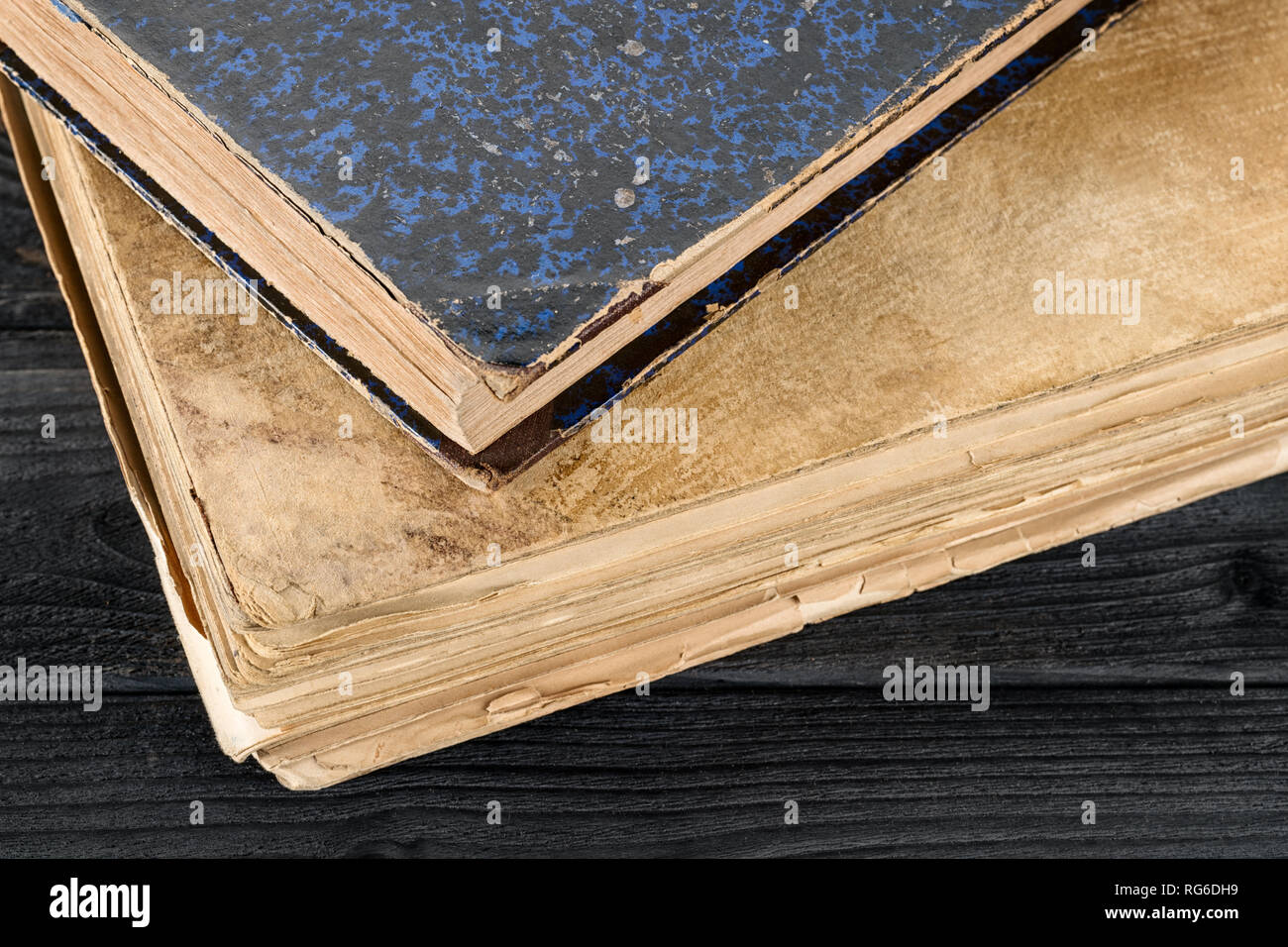 Two old books on the wooden table close up. literature, history, Knowledge and wisdom theme still life - Stock Image