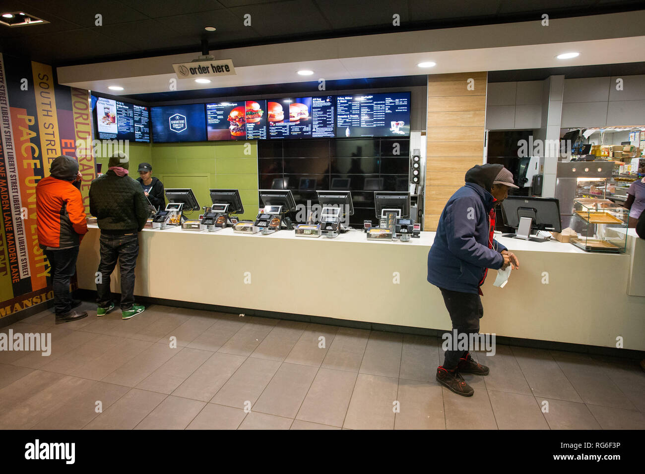 Counter inside a McDonalds fast food restaurant store, New York City, NY, USA. - Stock Image