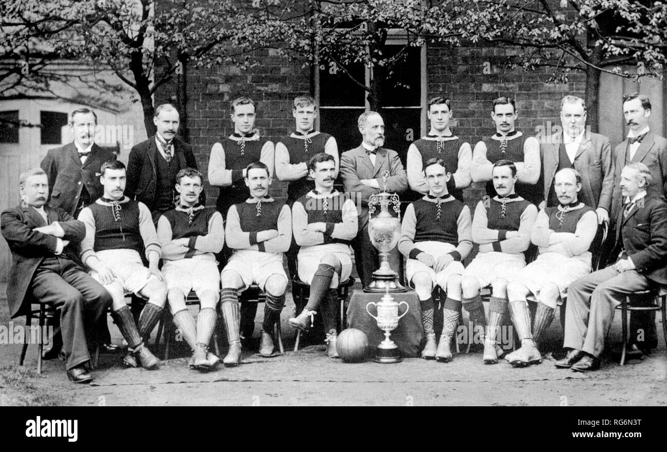 Aston Villa F.C. team photographed in 1897, after winning both the Football League and the FA Cup. Back row: George Ramsay (secretary), Joe Grierson (trainer), Howard Spencer, Jimmy Whitehouse, Joshua Margoschis (chairman), Albert Evans, Jimmy Crabtree, James Lees (director), C. Johnstone (director). Front row: Dr Victor Jones (director), James Cowan, Charlie Athersmith, Johnny Campbell, John Devey (captain), Fred Wheldon, John Cowan, John Reynolds, Frederick Rinder (director). 1897 - Stock Image