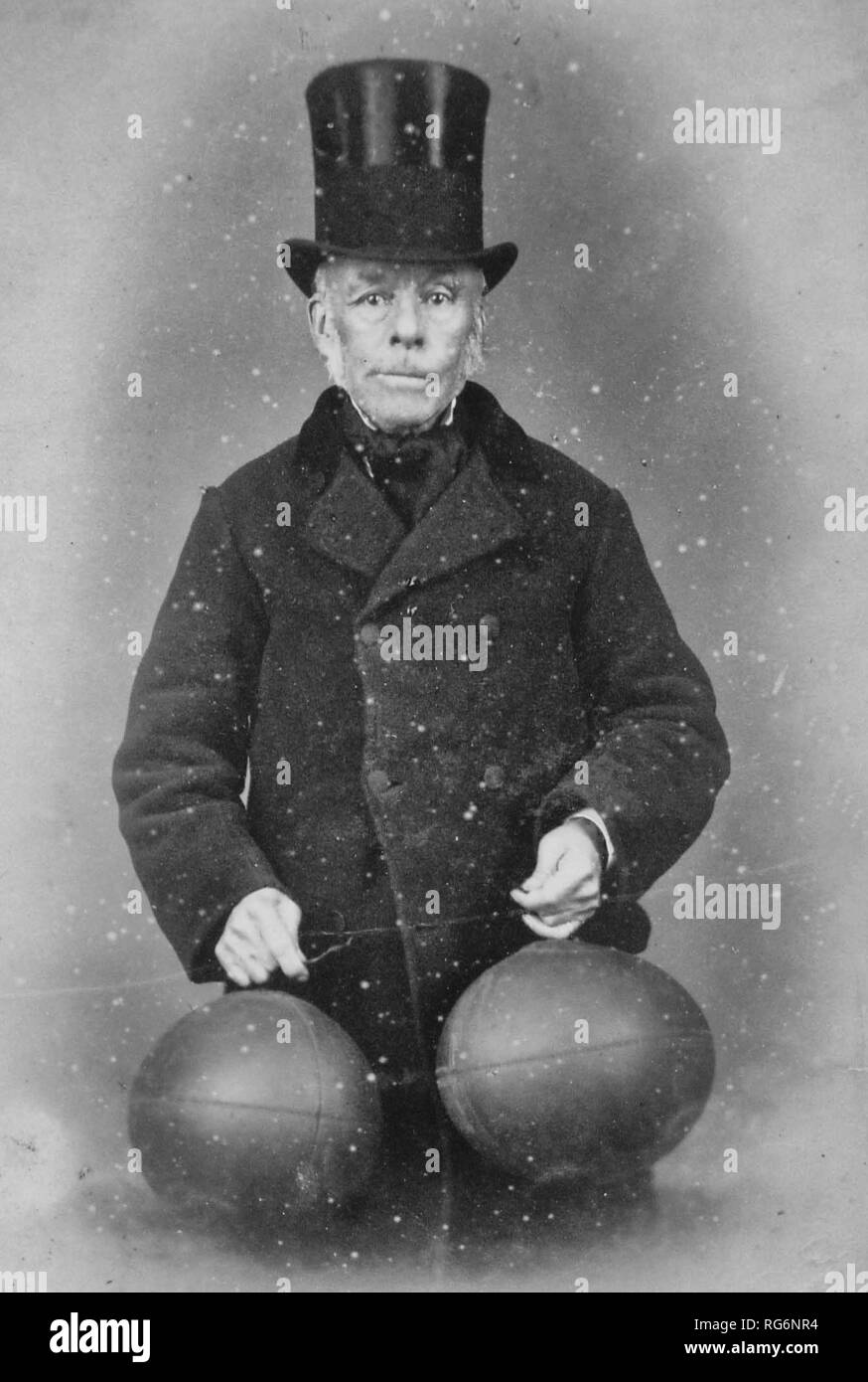Richard Lindon, believed to have invented the first footballs with rubber bladders, holding the new 'buttonless' balls, circa 1880 - Stock Image