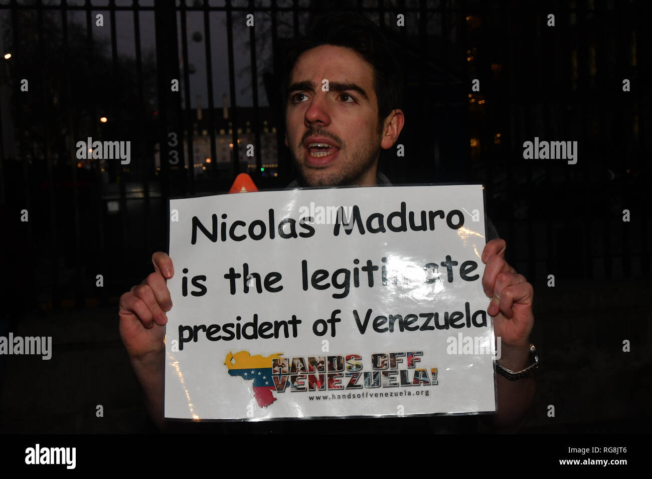 London, UK. 28th January 2019. The Latino community Reject imperialist against coup in Venezuel. Venezuelan people want their legitimate President Nicolás Maduro of Venezuela. The protestor also express the Latin nations will join together to fights the imperialist in any way and demand the Bank of England illegally holding 14 tonnes of Venezuelan gold itd should hand back to the Venezuelan authorities opposite Downing Street on 28 January 2019, London, UK. Credit: Picture Capital/Alamy Live News - Stock Image