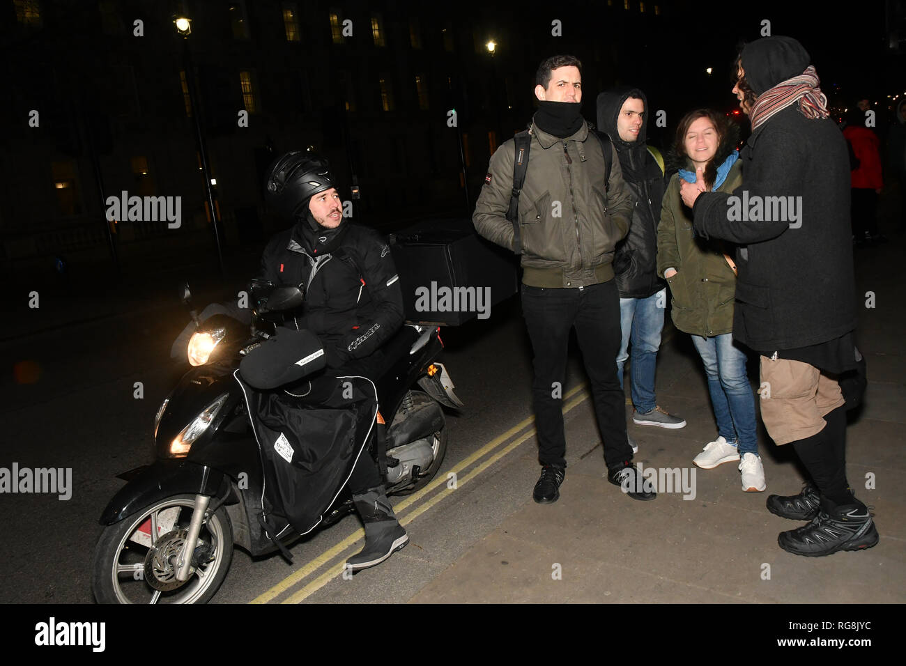 London, UK. 28th January 2019. Only four opposition support shouting slogan during the protest to Reject imperialist coup in Venezuel and the Venezuela patriots and supporters shout back you tratior opposite Downing Street, on 28 January 2019, London, UK. Credit: Picture Capital/Alamy Live News - Stock Image