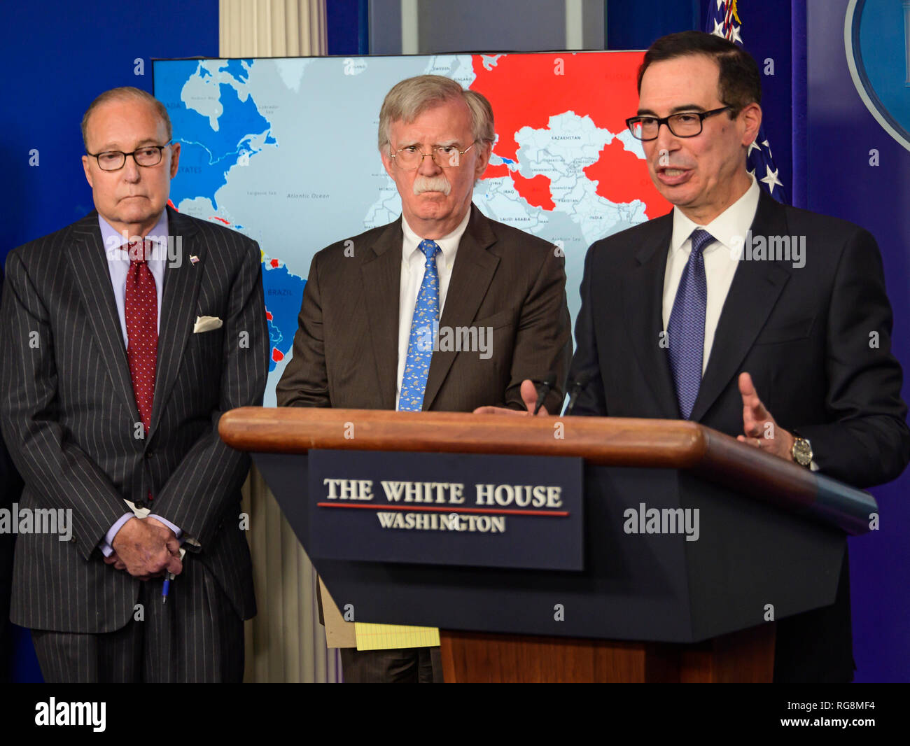 United States Secretary of the Treasury Steven T. Mnunchin, right, conducts a briefing with National Security Advisor John R. Bolton, center, in the Brady Press Briefing Room of the White House in Washington, DC on Monday, January 28, 2019. Bolton and Mnunchin announced that the administration had imposed sanctions on Petroleos De Venezuela S.A., the state-owned oil company of Venezuela, a move aimed to increase the pressure on President Nicolas Maduro to cede power to Juan Guaido. Looking on from left is Director of the National Economic Council Larry Kudlow. Credit: Ron Sachs/CNP /MediaP - Stock Image
