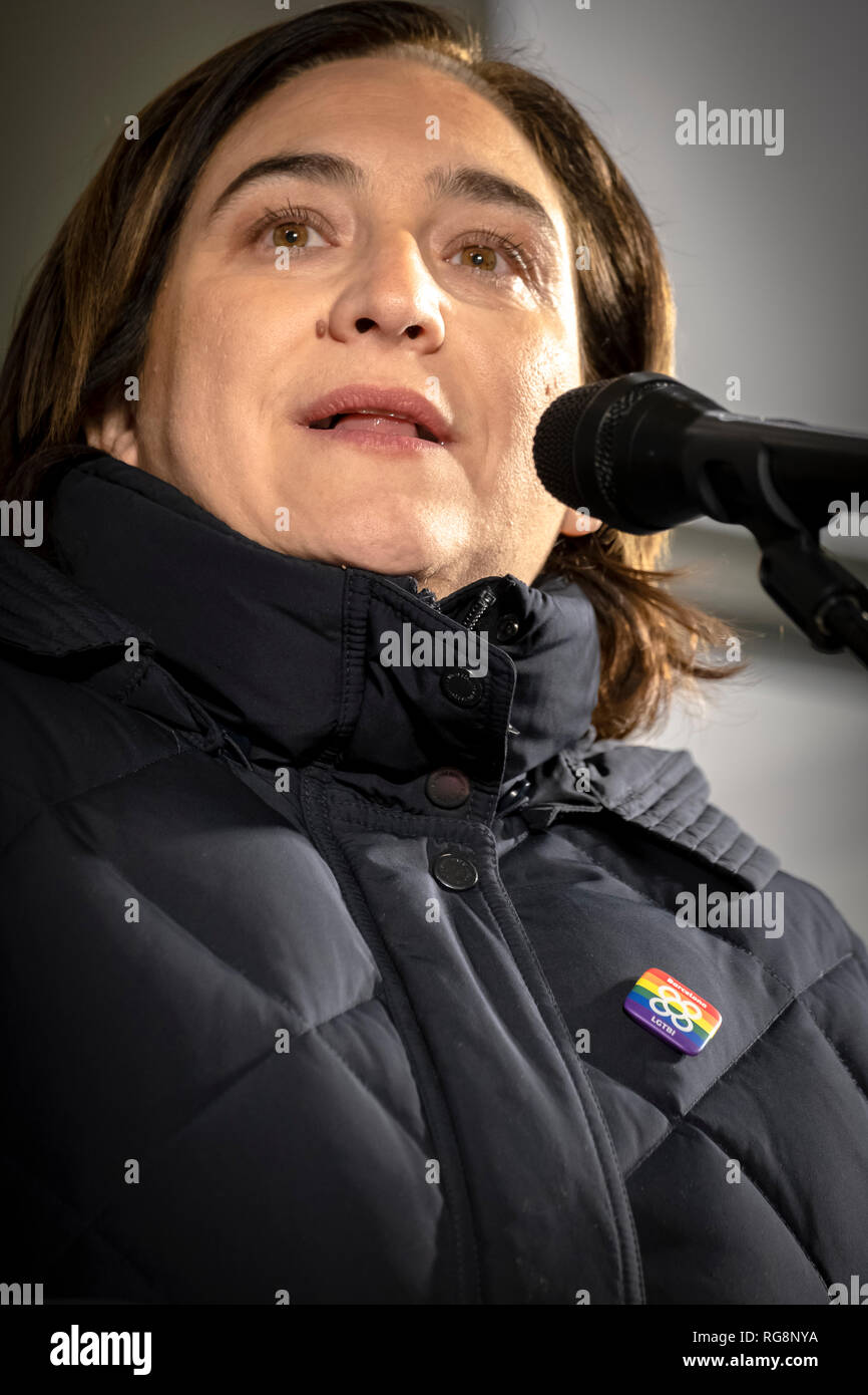 The mayor of Barcelona Ada Colau is seen making a speech during the rally. The LGTBI community, with the support of the mayor of Barcelona Ada Colau, have made an act of protest against the fascist attack against the new headquarters of the collective LGTBI. The first LGTBI center in Catalonia appeared with death threat texts and broken glass after the launching. - Stock Image