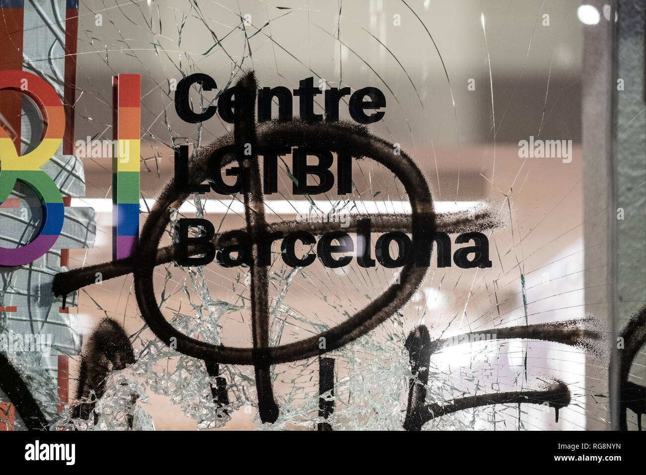 Written death threats are seen on the window of the new LGTBI center in Barcelona during the protest. The LGTBI community, with the support of the mayor of Barcelona Ada Colau, have made an act of protest against the fascist attack against the new headquarters of the collective LGTBI. The first LGTBI center in Catalonia appeared with death threat texts and broken glass after the launching. - Stock Image