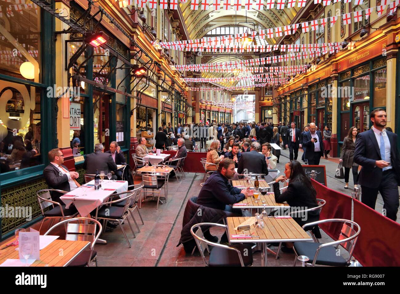 LONDON, UK - APRIL 22, 2016: People celebrate Saint George's Day in Leadenhall Market, London. Saint George is the patron saint of England. Stock Photo