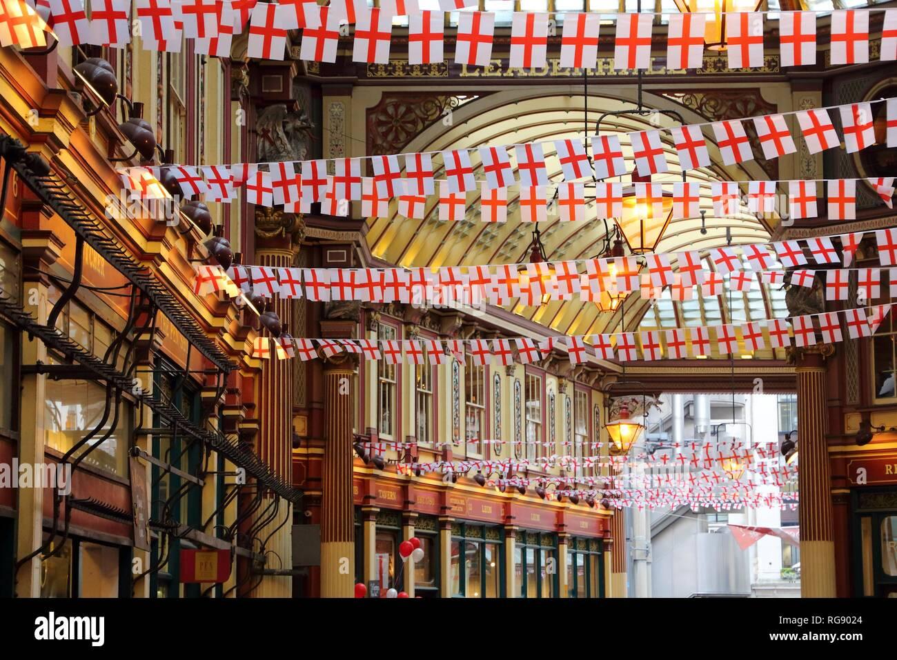 LONDON, UK - APRIL 22, 2016: Saint George's Day decorations in Leadenhall Market, London. Saint George is the patron saint of England. Stock Photo