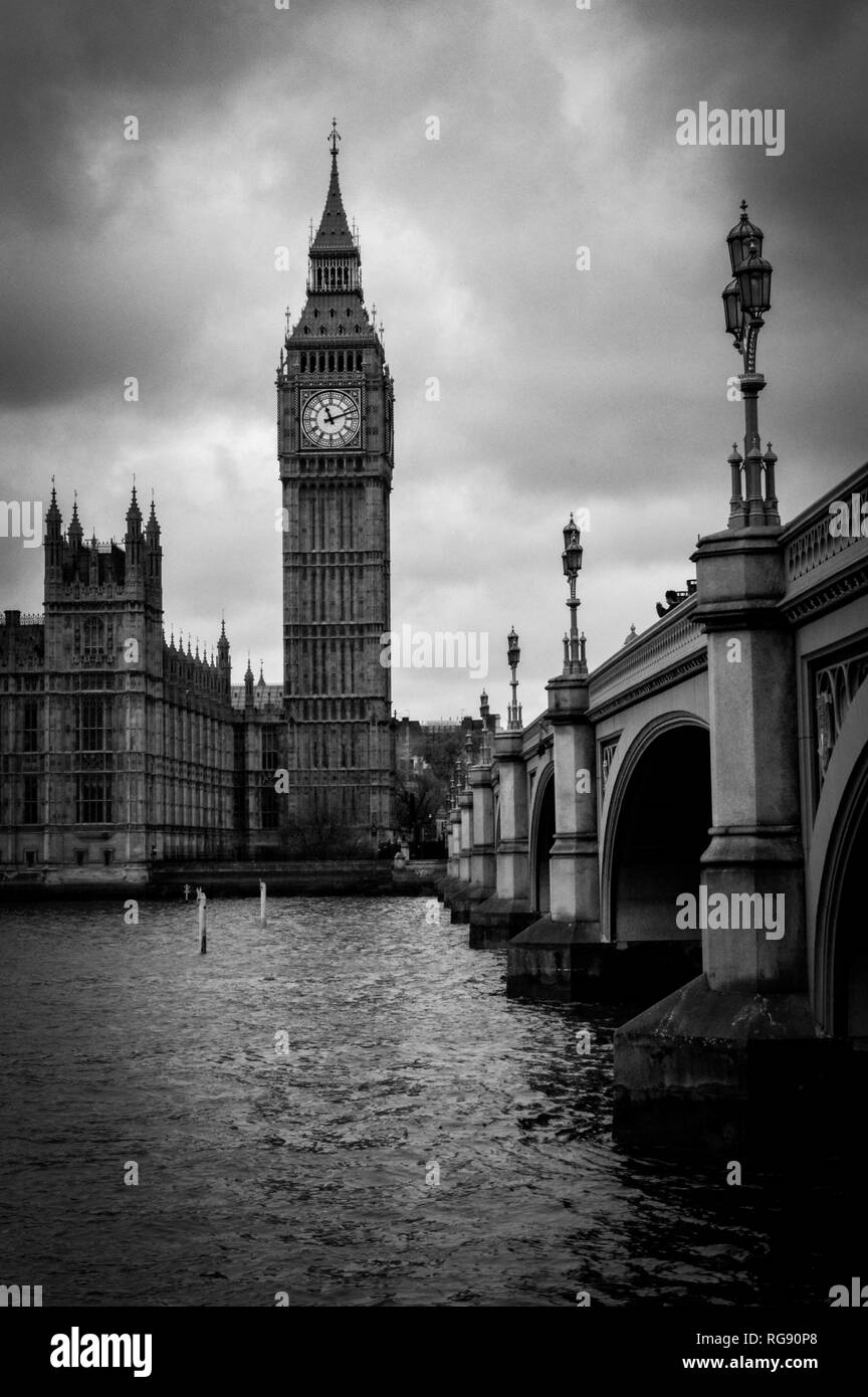London, the UK.  Over the river view of Big Ben, the Palace of Westminster and Westminster Bridge. The icons of England in black and white. - Stock Image