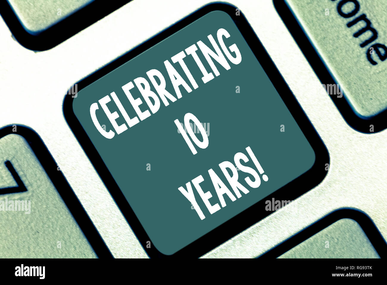 Writing note showing Celebrating 10 Years. Business photo showcasing Commemorating a special day Decennial anniversary Keyboard key Intention to creat Stock Photo